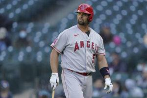 ASSOCIATED PRESS                                 Los Angeles Angels' Albert Pujols walks to the dugout after he was called out on strikes during the ninth inning of a baseball game against the Seattle Mariners, Sunday, in Seattle.