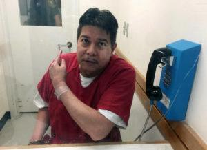 ASSOCIATED PRESS                                 Randall Saito points to a guard as he sits in an inmate visitor's booth at San Joaquin County Jail before a scheduled court hearing in French Camp, Calif., on Nov. 17, 2017.
