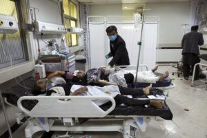 ASSOCIATED PRESS                                 Afghan school students are treated at a hospital after a bomb explosion near a school in west of Kabul, Afghanistan. A bomb exploded near a school in west Kabul on Saturday, killing several, many them young students, Afghan government spokesmen said.