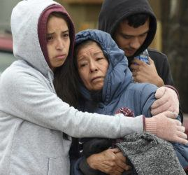 JERILEE BENNETT/THE GAZETTE VIA ASSOCIATED PRESS                                 Family members mourned at the scene where their loved ones were killed, early Sunday, in Colorado Springs, Colo. The suspected shooter was the boyfriend of a female victim at the party attended by friends, family and children.