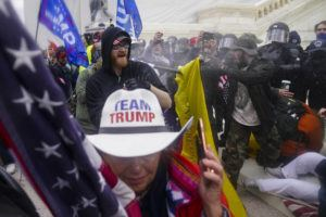 ASSOCIATED PRESS                                 Rioters tried to break through a police barrier, Jan. 6, at the Capitol in Washington.
