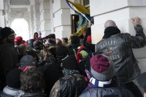 ASSOCIATED PRESS                                 Insurrectionists loyal to President Donald Trump tried to open a door of the U.S. Capitol, Jan. 6, as they rioted in Washington. With riot cases flooding into Washington's federal court, the Justice Department is under pressure to quickly resolve the least serious cases.