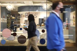 ASSOCIATED PRESS / MAY 4                                 People walk past Sugar Bliss Bakery in Chicago's famed Loop.