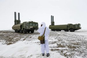 ASSOCIATED PRESS                                 An officer speaks on walkie-talkie as the Bastion anti-ship missile systems take positions on the Alexandra Land island near Nagurskoye, Russia, Monday.