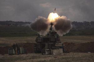 ASSOCIATED PRESS                                 An Israeli artillery unit fires toward targets in the Gaza Strip, at the Israeli Gaza border, Monday.