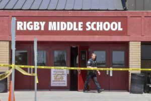 ASSOCIATED PRESS                                 A police officer walks out of Rigby Middle School following a shooting there on May 6 in Rigby, Idaho. Authorities said that two students and a custodian were injured, and a female student has been taken into custody.