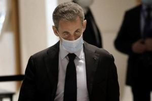 ASSOCIATED PRESS / 2020                                 Former French President Nicolas Sarkozy arrives at the courtroom in Paris.