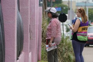 """ASSOCIATED PRESS / MAY 20                                 Pam Miller, an anti-abortion sidewalk counselor, left, speaks through the tarp draped fencing of the Jackson Womens Health Organization clinic, to an incoming patient at the front of the """"pink house,"""" while clinic escort Kim Gibson counters her statements in Jackson, Miss. The clinic is Mississippi's only state-licensed abortion facility."""