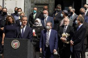 ASSOCIATED PRESS / MAY 20                                 Los Angeles Mayor Eric Garcetti, at the podium, speaks in front of civic and faith leaders outside City Hall in Los Angeles. Faith and community leaders in Los Angeles called for peace, tolerance and unity in the wake of violence in the city that is being investigated as potential hate crimes. Los Angeles police on Saturday, May 22, announced the arrest of a suspect in an alleged attack by a pro-Palestinian group on Jewish men outside a restaurant earlier in the week.