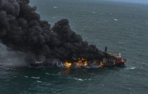 ASSOCIATED PRESS                                 In this photo provided by Sri Lanka Air Force, smoke rises from the container vessel MV X-Press Pearl engulfed in flames off Colombo port, Sri Lanka, today. An explosion occurred Tuesday on a ship anchored off Sri Lanka's capital on which a fire had been burning for several days, prompting the evacuation of all crew members, officials said.