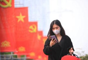 ASSOCIATED PRESS / JAN. 23                                 A woman wearing face mask looks at her phone in Hanoi, Vietnam. Vietnam says it has discovered a new coronavirus variant that's a hybrid of strains first found in India and the U.K. The Vietnamese health minister made the announcement Saturday, May 29.