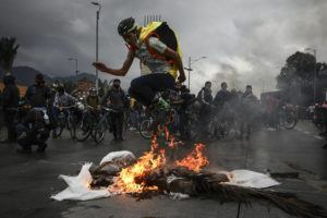 ASSOCIATED PRESS                                 An anti-government demonstrator in skates jumps over a fire during a protest in Bogota, Colombia.
