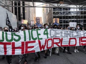 NEW YORK TIMES / MARCH 29                                 Hundreds of protesters march during a rally sparked by the death of George Floyd on the first day of police officer Derek Chauvin's trial, in Minneapolis.