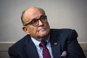 NEW YORK TIMES / 2020                                 Rudy Giuliani, then President Donald Trump's personal lawyer, looks on as Trump speaks to reporters at the White House.