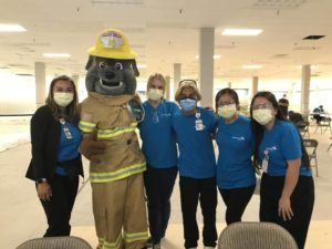 Courtesy Honolulu Fire Department                                 Poki, the HFD fire mascot, poses for a photo today with Adventist Health Castle staff at Windward Mall