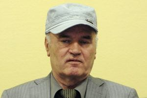 ASSOCIATED PRESS                                 Former Bosnian Serb Gen. Ratko Mladic sits in the court room during his initial appearance at the U.N.'s Yugoslav war crimes tribunal in The Hague, Netherlands, in 2011.