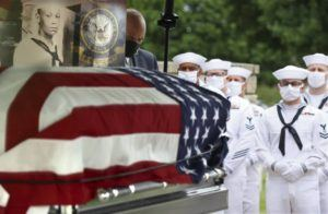 ST. LOUIS POST-DISPATCH VIA AP                                 The casket with the remains of Mess Attendant 3rd Class Isaac Parker, 17, is positioned during his funeral ceremony with full military honors at Jefferson Barracks National Cemetery, in St. Louis County, Mo., on Tuesday.