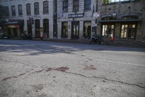 AARON MARTINEZ/AUSTIN AMERICAN-STATESMAN VIA AP                                 Blood stains remain on 6th Street after an early morning shooting in downtown Austin, Texas. Authorities say someone opened fire on the busy entertainment district wounding several people before getting away.
