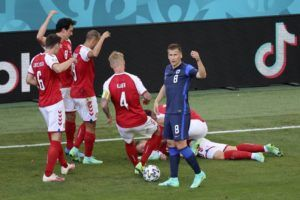 STUART FRANKLIN/POOL VIA AP                                 Denmark's players go to his teammate Christian Eriksen after he collapsed during the Euro 2020 soccer championship group B match between Denmark and Finland at Parken stadium in Copenhagen, Denmark, Saturday, June 12.