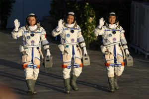 ASSOCIATED PRESS                                 Chinese astronauts, from left, Tang Hongbo, Nie Haisheng, and Liu Boming wave as they prepare to board for liftoff at the Jiuquan Satellite Launch Center in Jiuquan in northwestern China, Thursday.