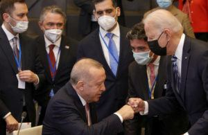 ASSOCIATED PRESS                                 U.S. President Joe Biden, right, is greeted by Turkey's President Recep Tayyip Erdogan, center, during a plenary session at a NATO summit in Brussels on Monday.