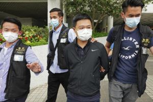 ASSOCIATED PRESS                                 Ryan Law, second from right, Apple Daily's chief editor, was arrested by police officers in Hong Kong, Thursday. Hong Kong police on Thursday morning arrested the chief editor and four other senior executives of Apple Daily under the national security law on suspicion of collusion with a foreign country to endanger national security, according to local media reports.