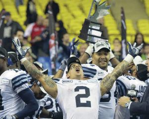 """ASSOCIATED PRESS / 2012                                 Chad Owens hosts """"The CO2 RUN DWN,"""" the Honolulu Star-Advertiser's Facebook Live sports talk show. Owens is shown here celebrating a Toronto Argonauts' victory in Montreal."""