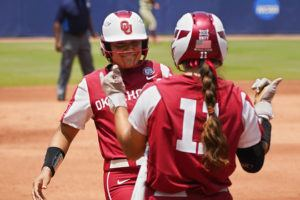ASSOCIATED PRESS                                 Oklahoma's Jocelyn Alo, left, celebrates her home run with Nicole Mendes (11) against Florida State in the first inning of the final game of the NCAA Women's College World Series softball championship series today in Oklahoma City. The Sooners won the championship game, 5-1
