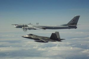"""COURTESY NORAD                                 An F-22 fighter intercepted a Russian """"Bear"""" Tu-95 bomber off Alaska in 2019. Citing U.S. defense officials, CBS said the United States scrambled the F-22s from Hawaii on Sunday in response to Russian bomber flights, but the aircraft did not enter the Air Defense Identification Zone and were not intercepted."""