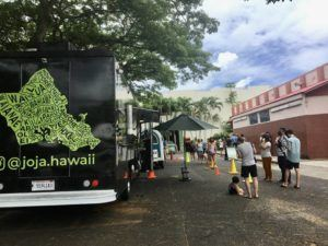 NINA WU/NWU@STARADVERTISER.COM                                 Kailua Farmer's Market will hold its last market at the Pali Lanes parking lot this Sunday. The market is in the process of finding a new location.