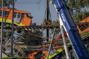 NEW YORK TIMES / MAY 4                                 A derailed subway train is held aloft by cranes after the track collapsed in Mexico City.