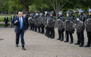 NEW YORK TIMES / 2020                                 President Donald Trump walks past Secret Service officers in riot gear upon his return to the White House after posing for photographs at St. John's church in Washington.