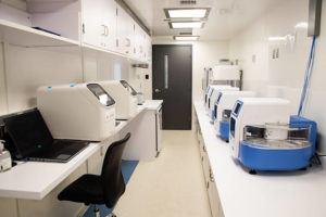 CRAIG T. KOJIMA / 2020                                 Inside the COVID-19 mobile testing laboratory at the Daniel K. Inouye International Airport.