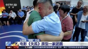 CCTV VIA ASSOCIATED PRESS                                 Guo Gangtang, at right, embraced his long-lost son Guo Xinzhen during a reunion after 24 years in Liaocheng in Central China's Shandong province on Sunday. Guo was abducted as a toddler outside their home.