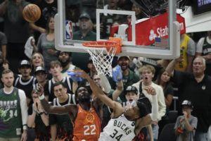 ASSOCIATED PRESS                                 Milwaukee Bucks forward Giannis Antetokounmpo blocks a shot by Phoenix Suns center Deandre Ayton during the second half.