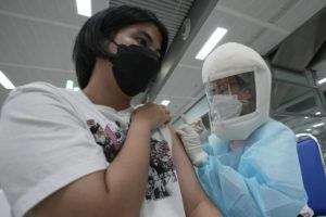 ASSOCIATED PRESS                                 A health worker administers a dose of the AstraZeneca COVID-19 vaccine at the Central Vaccination Center in Bangkok, Thailand, today.