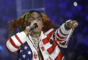 ASSOCIATED PRESS                                 Rapper Daniel Hernandez, known as Tekashi 6ix9ine, performs in Milan, Italy, in 2018. Bodyguards for the troubled rapper turned New York City into the Wild West last summer, piling into SUVs and chasing a man for 20 blocks with lights flashing after he attempted to record cellphone video of the recording star, prosecutors said today.
