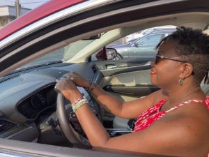 ASSOCIATED PRESS                                 Jessica Pitts sat behind the wheel of a 2019 Lincoln MKC on the lot of Jack Demmer Lincoln in Dearborn, Mich., Monday. Pitts bought the used car at the dealership.