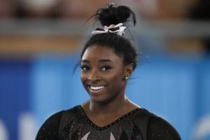 ASSOCIATED PRESS / JULY 22                                 Simone Biles of the United States smiles as she trains for artistic gymnastics at Ariake Gymnastics Centre ahead of the 2020 Summer Olympics in Tokyo, Japan.