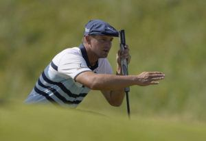 ASSOCIATED PRESS                                 Bryson DeChambeau gestures as he lines up his putt on the 2nd green during the third round of the British Open Golf Championship on July 17.