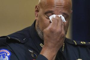 ASSOCIATED PRESS                                 Washington Metropolitan Police Department officer Daniel Hodges wipes his eyes during the House select committee hearing on the Jan. 6 attack on Capitol Hill in Washington Tuesday.