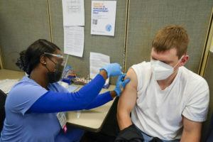 ASSOCIATED PRESS                                 A registered nurse gives James Mullen the second dose of the coronavirus vaccine at a COVID-19 vaccination site at NYC Health + Hospitals Metropolitan, Thursday in New York in February.