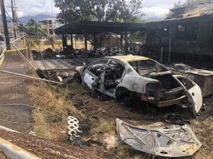 CRAIG T. KOJIMA / CKOJIMA@STARADVERTISER.COM                                 The Honolulu Fire Department is investigating a fire that destroyed the house at 87-794 Farrington Highway near the intersection of Maipalaoa Road in Maili overnight.