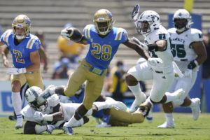 ASSOCIATED PRESS                                 UCLA Bruins running back Brittain Brown (28) runs the ball today during the first half of an NCAA college football game against the Hawaii Warriors in Pasadena, Calif.