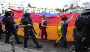 ASSOCIATED PRESS                                 Participants in colorful 3rd Equality Parade march with rainbow flags under heavy police presence in support of LGBT rights at the foot of Poland's most revered Catholic shrine, the Jasna Gora Monastery in Czestochowa, Poland. Under the massive police presence there were no clashes with a simultaneous small gathering of right-wing groups who held anti-LGBT rights banners.