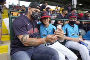 ASSOCIATED PRESS                                 Cleveland Indians' Wilson Ramos, left, took a photo with Manchester Conn.'s Paul Virdokian as they sat in the stands at Lamade Stadium during a baseball game between Hastings, Neb., and Honolulu, at the Little League World Series in South Williamsport, Pa., Aug. 22.