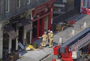 ANDREW MILLIGAN/PA VIA AP                                 Firefighters at the scene after a fire at the Elephant House Cafe in Edinburgh. An Edinburgh cafe where author J.K. Rowling wrote some of the Harry Potter books has been damaged in a fire. The Elephant House in the Scottish capital was blackened by a blaze which broke out at the patisserie next door on Tuesday.