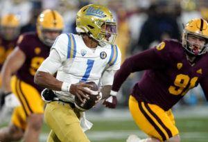 ASSOCIATED PRESS                                 UCLA quarterback Dorian Thompson-Robinson scrambles during the first half against Arizona State on Dec. 5.