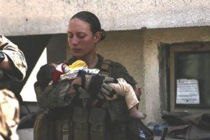 U.S. DEPARTMENT OF DEFENSE VIA AP/ AUG. 20                                 This undated photo provided by U.S. Department of Defense Twitter page shows Sgt. Nicole Gee holding a baby at Hamid Karzai International Airport in Kabul, Afghanistan. Officials said Saturday that Sgt. Nicole Gee of Sacramento, Calif., was killed in Thursday's bombing in Kabul, Afghanistan.
