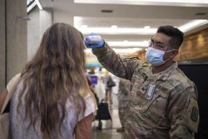 STAR-ADVERTISER                                 Hawaii Army National Guard Spc. James Falcon screened an interisland passenger, in June 2020, at the Daniel K. Inouye International Airport.                                 A federal extension has been granted through December for Hawaii National Guard COVID-19 assistance around the state with the explosion of delta variant cases.